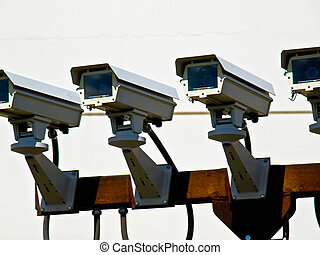 Closeup of Four Security Cameras Performing Surveillance