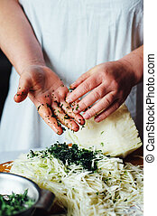 Vegetarians and cooking Ladies hand cut green vegetable,...
