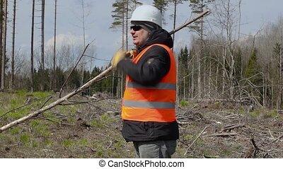 Lumberjack speaks in the woods