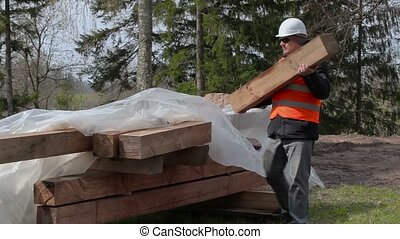 Worker carries building materials