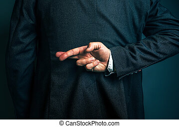 Lying businessman holding fingers crossed behind his back -...