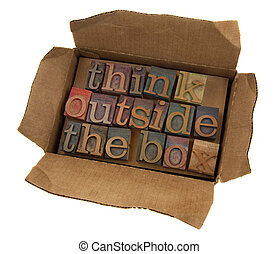 think outside the box concept, words in vintage letterpress...