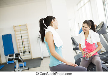 Two young women in the gym