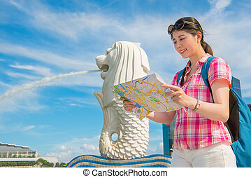 Happy Asia woman Travel in Singapore, Merlion Park - Happy...