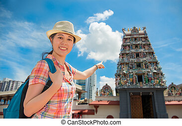 Happy Asia woman Travel in Singapore, Sri Mariamman Temple -...