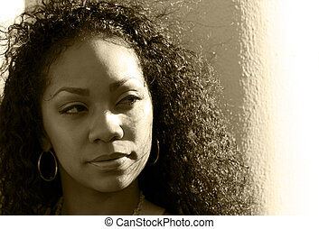 Sepia portrait of young black woman - Dramatic portrait of a...