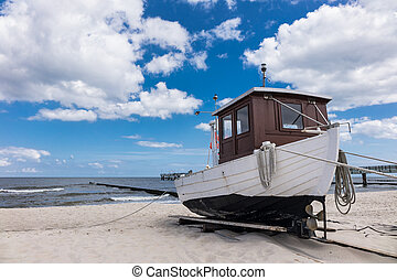 A fishing boat on shore of the Baltic Sea in Koserow Germany...