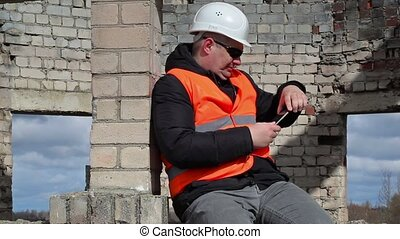 Civil engineer sitting and take pictures on tablet PC
