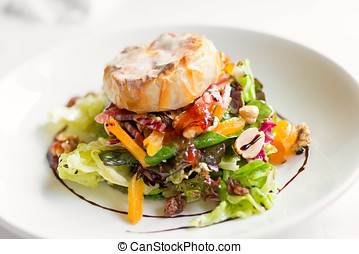 Salad dish with cheese - Detail of a plate of salad with hot...