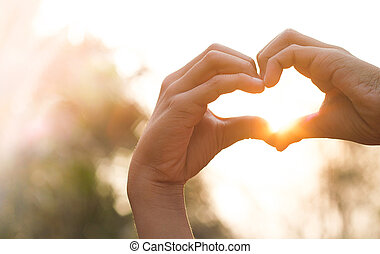 Hands in heart form love.