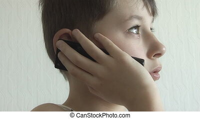 Boy woke up calls on a mobile phone