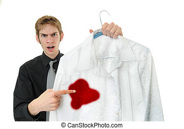 Stain - Unsatisfied customer holds up a dry cleaned suit....