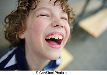 Fun laughing boy - Boy laughs. He opened his mouth. It has...