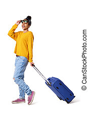 Happy young woman going on a holiday - Full length portrait...