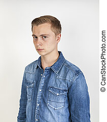 portrait of angry looking  boy posing in studio