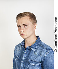 portrait of angry looking  boy posing in studio