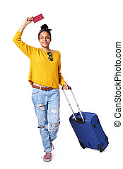 Trendy young woman going on vacation - Full length portrait...