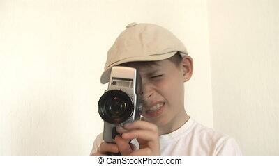 Boy shoots a film movie camera - Boy shoots a film on 8mm...