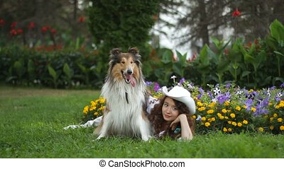 girl with dog resting in a clearing in the Park