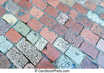 Pavement of old multi-colored stone - The pavement of the...