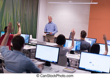 teacher and students in computer lab classroom - handsome...