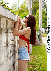 Girl in bikini and shorts near fence. - Pretty beautiful...