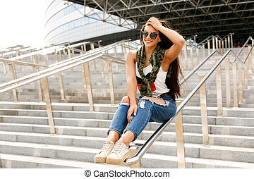 Happy girl on railing - Happy beautiful girl in trendy...