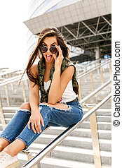Happy girl on railing - Happy beautiful girl with long...