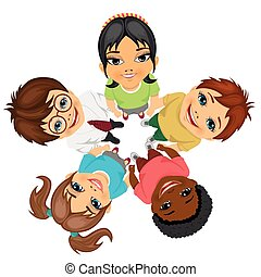 Group of multiracial kids in a circle looking up holding...