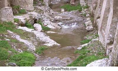 View on creek flowing among stones and ruins Georgia