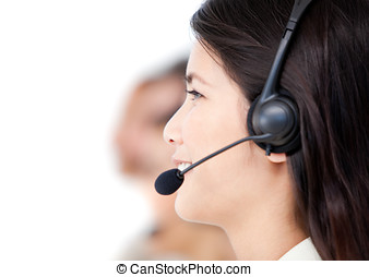 Close-up of business people with headset on standing against a white background
