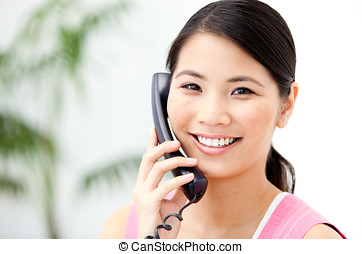 Portrait of a cheerful businesswoman talking on phone