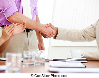 Close-up of two business partners closing a deal