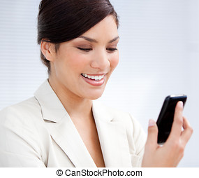 Charming businesswoman using a mobile phone - Portrait of a...