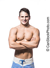 Portrait of a handsome young muscular man in swimwear with...