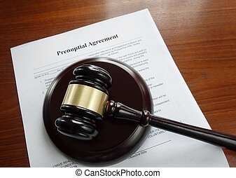 Prenup and gavel - Prenup agreement on a desk with legal...