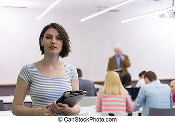 portrait of happy female student in classroom - portrait of...