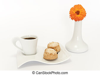 scons cup of coffee with fruit and orange flower vase