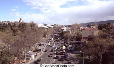 Georgia View of road traffic in sunny spring day - Tbilisi,...