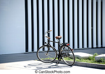 Old bike - An old bicycle stands in front of the facade of a...