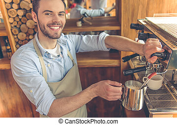 Handsome barista at cafe - Handsome young barista is making...
