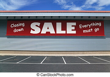 Closing down sale - Retail building with a banner on the...
