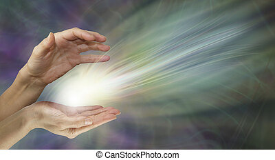 Healer sending healing energy - Female healers hands with a...