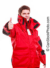 Man wearing protective clothing. Young male in red oilskin....