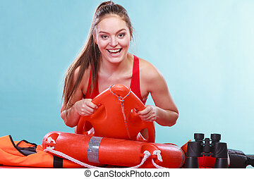 Happy lifeguard woman lying on rescue ring buoy - Happy...