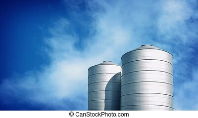 Large Silos On Sunny Day - Couple of large metal silo...