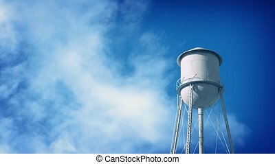 Water Tower With Clouds Passing - Water tower structure on...