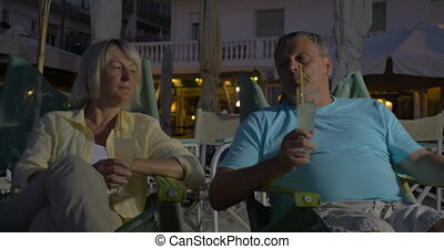 Senior adult man and woman drinking cocktails - Wife and...
