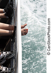 Woman Feet - Woman feet with red nails between other...