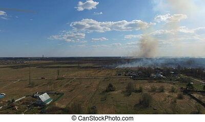 Burning grass near village Aerial footage